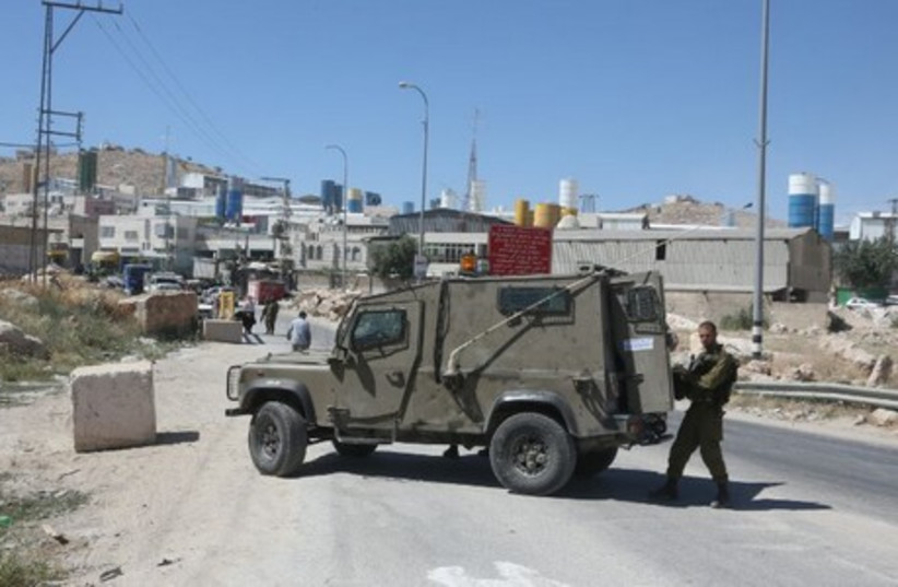 IDF soldiers in southern entrance of Hebron. June 15 (photo credit: MARC ISRAEL SELLEM/THE JERUSALEM POST)