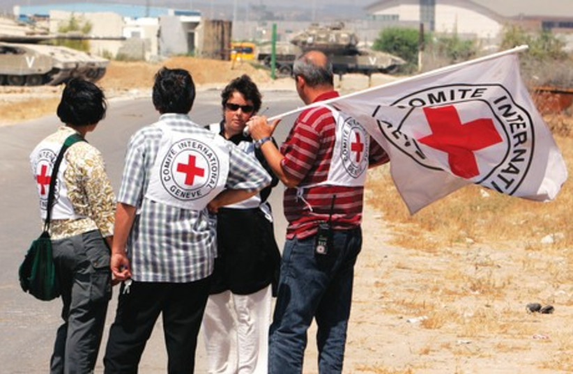 Members of the International Committee of the Red Cross stand near Erez Crossing in 2007. (photo credit: REUTERS)