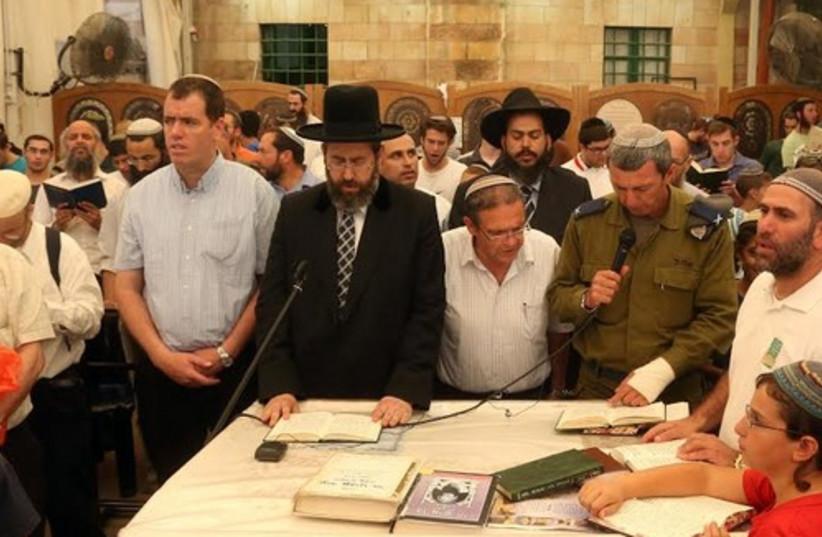Rabbi Lau leading prayers in Hebron, June 18, 2014. (photo credit: MARC ISRAEL SELLEM)