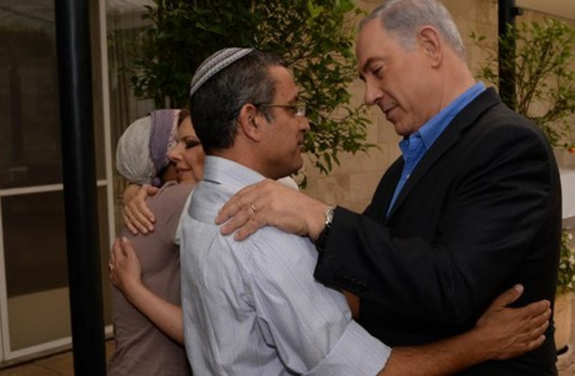 Prime Minister Binyamin Netanyahu and his wife Sara meet with the parents of the three kidnapped teens (photo credit: GPO)