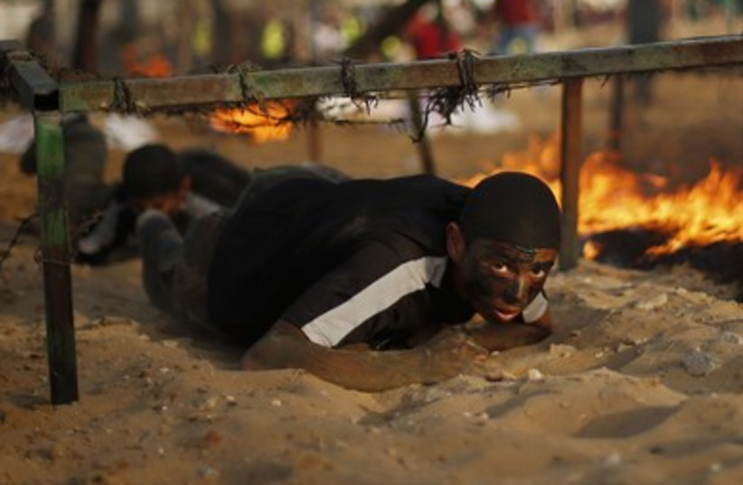 Palestinian youngsters in Gaza take part in a Hamas military training camp. (photo credit: REUTERS)