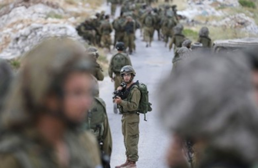 IDF soldiers from the Paratroopers Brigade search for the missing teens near Hebron. (photo credit: REUTERS)