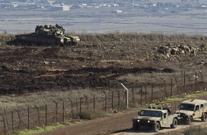 An Israeli tank is seen on the Golan Heights. (photo credit: REUTERS)