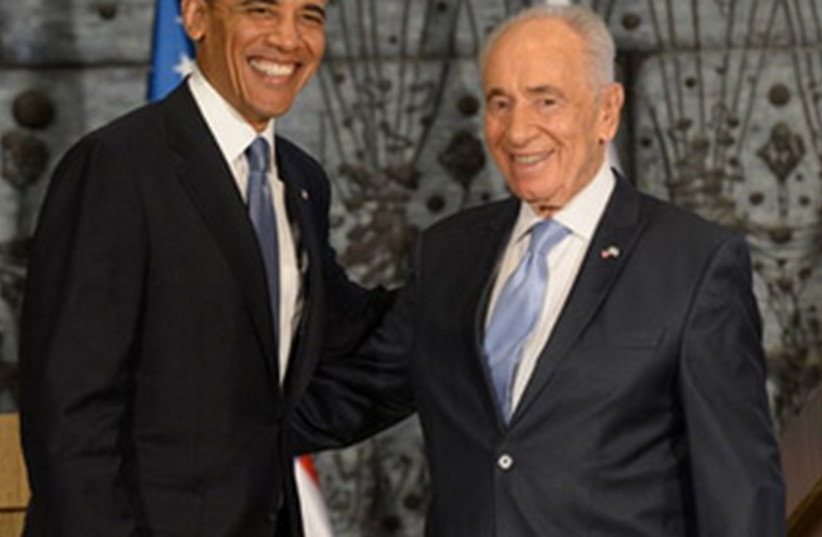 President Shimon Peres meets with US President Barack Obama, March 20, 2013.  (photo credit: AMOS BEN-GERSHOM/GPO)