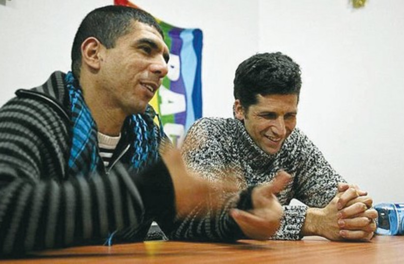 Sulaiman Khatib (left) and Avner Wishnitzer, co-directors for the NGO Combatants for Peace, speak during an interview in 2006. (photo credit: COURTESY SULAIMAN KHATIB)