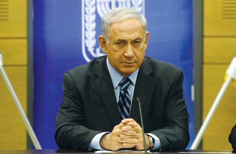 Binyamin Netanyahu speaks at the Knesset on Monday (photo credit: MARC ISRAEL SELLEM/THE JERUSALEM POST)