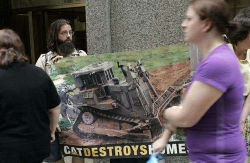Protesters gather outside the Caterpillar annual shareholder meeting in Chicago to demonstrate against how Israel acquires Caterpillar heavy machinery from the US. (photo credit: REUTERS)