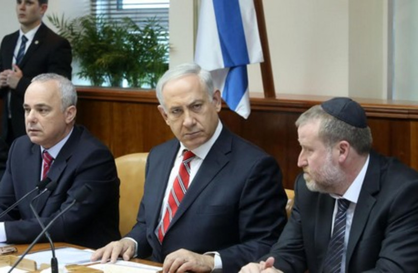 Prime Minister Binyamin Netanyahu speaks at the weekly cabinet meeting, June 29, 2014 (photo credit: MARC ISRAEL SELLEM/THE JERUSALEM POST)