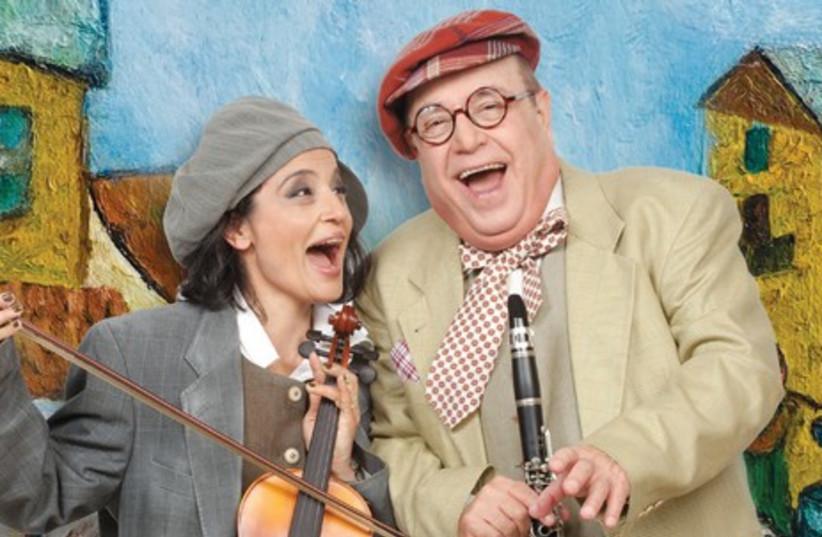 IRMA STEPANOV and Tuvia Tsafir in 'Yidl Mitn Fidl.' (photo credit: GERAR ALON)