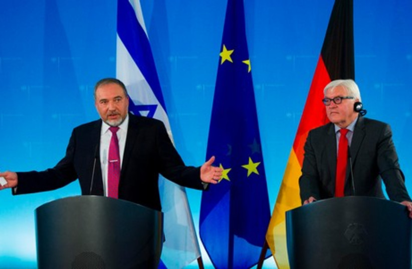 FM Liberman and German counterpart Frank-Walter Steinmeier (photo credit: REUTERS)