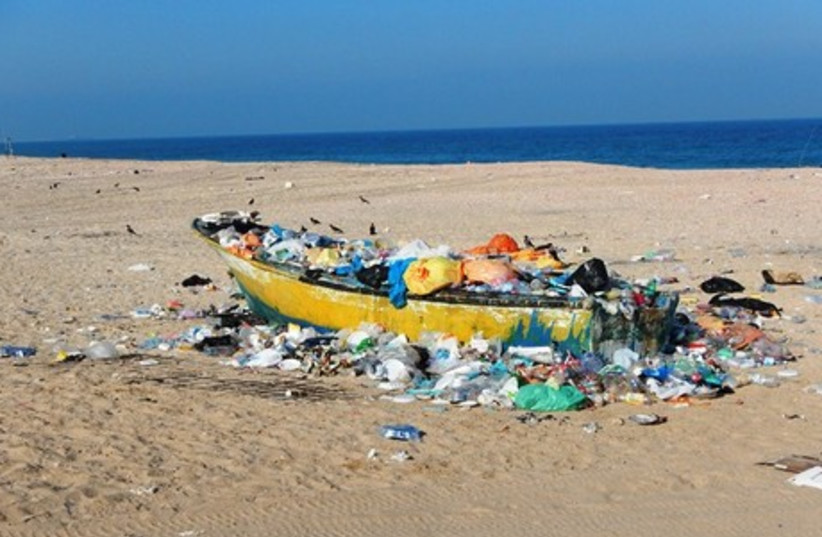 Beach pollution  (photo credit: DORON ARIELI, MINISTRY OF ENVIRONMENTAL PROTECTION)