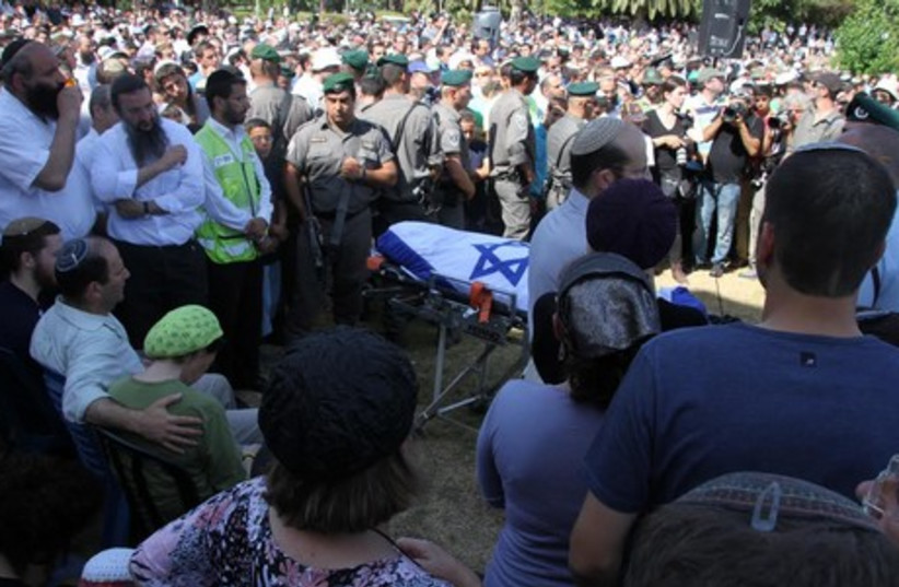 The Fraenkel family at the funeral for their slain son Naftali, July 1, 2014. (photo credit: TOVAH LAZAROFF)