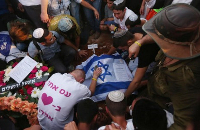 Funeral for the three kidnapped Israeli teens, July 1, 2014. (photo credit: MARC ISRAEL SELLEM/THE JERUSALEM POST)