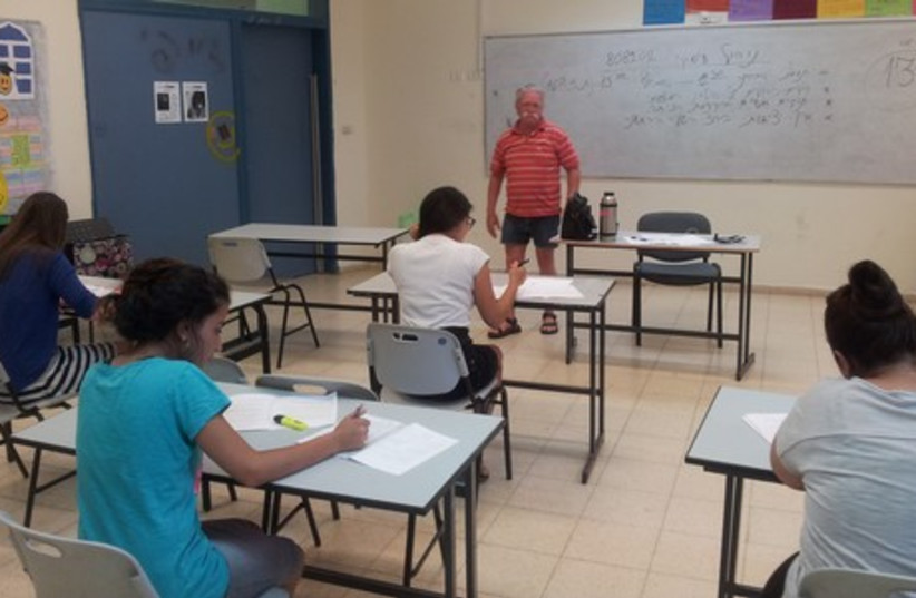 Students from the AMIT religious campus in Sderot finishing their Bagrut exam. (photo credit: LIDAR GRAVÉ-LAZI)