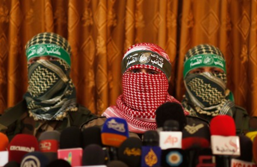 Hamas' armed wing spokesman speaks during a news conference in Gaza City July 3, 2014. (photo credit: REUTERS)