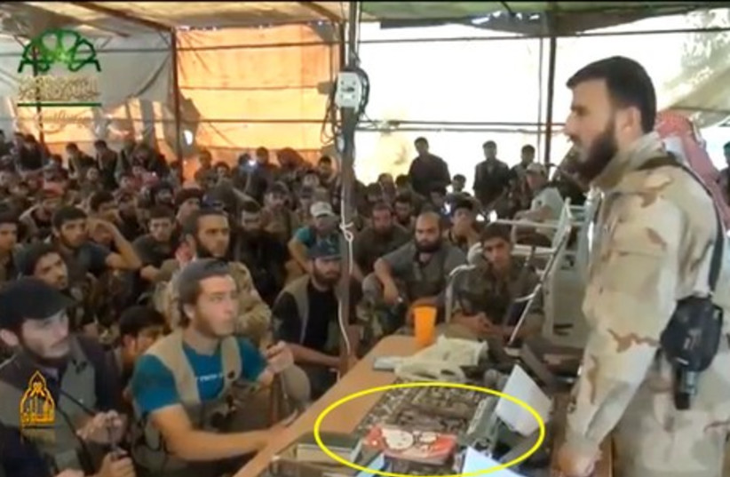 Sheikh Zahran Alloush with the Hello Kitty notebook by his side. (photo credit: YOUTUBE SCREENSHOT)