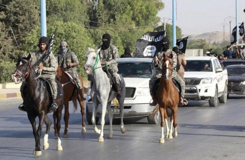 """Militants from """"Caliphate"""" The Islamic State  (photo credit: REUTERS)"""