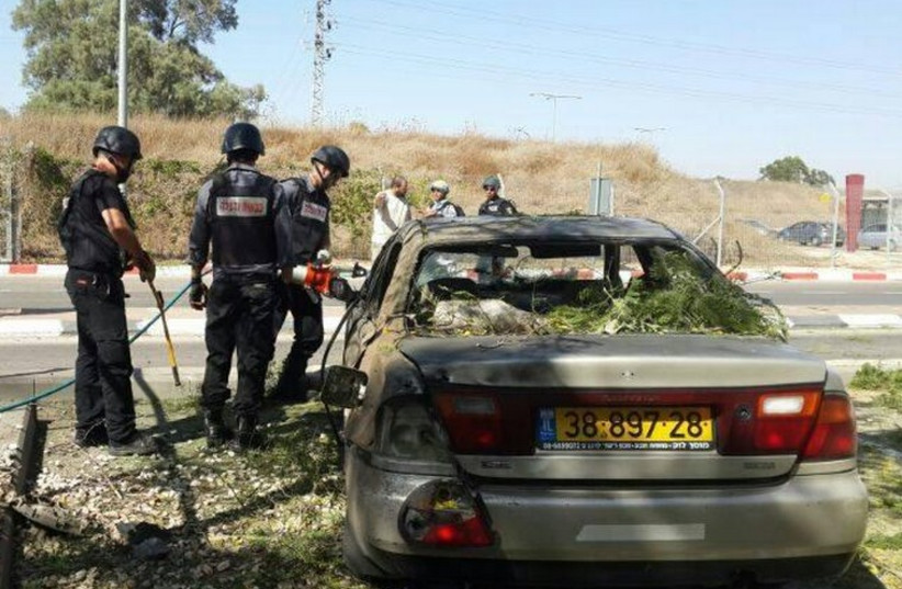 A parked car hit by a rocket in the Sha'ar Hanegev Regional Council. (photo credit: ISRAEL POLICE)