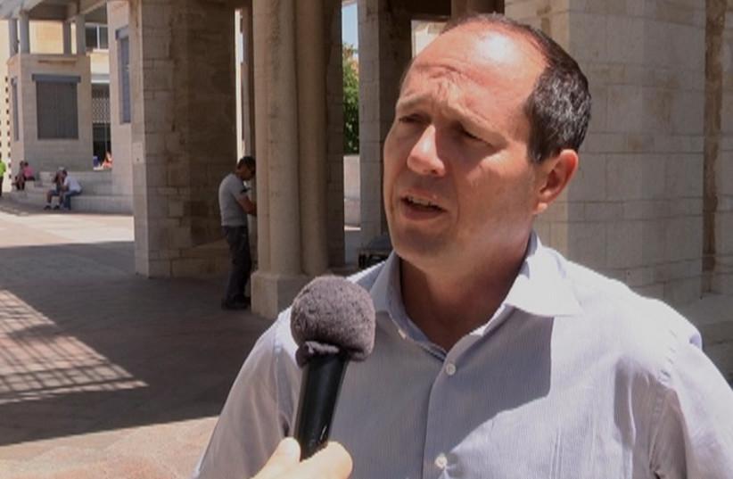 JERUSALEM MAYOR Nir Barkat speaks to The Jerusalem Post in City Hall's Safra Square Thursday morning, hours before six rockets invade Jerusalem air space.  (photo credit: ELI MANDELBAUM)