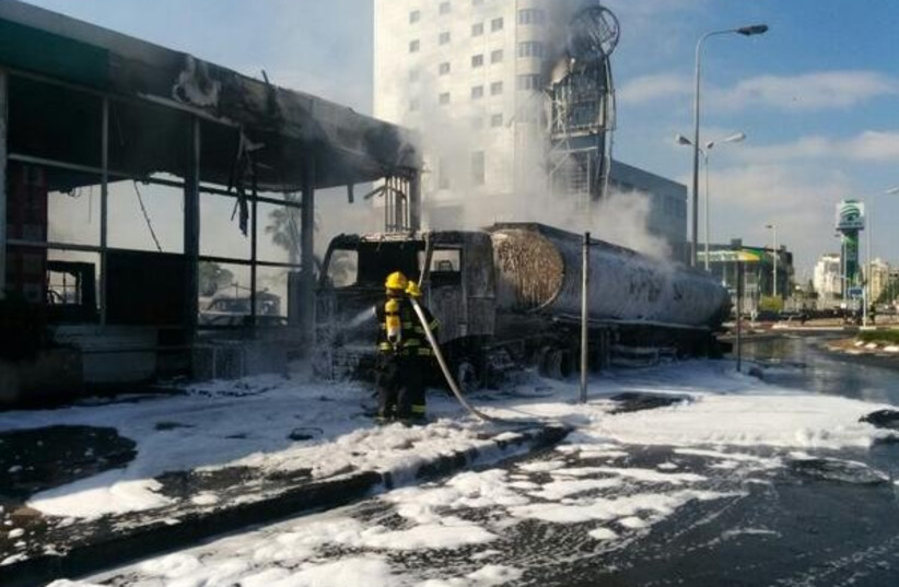 Scene of fire caused by rocket that struck next to Ashdod gas station, July 11, 2014. (photo credit: ISRAEL POLICE)