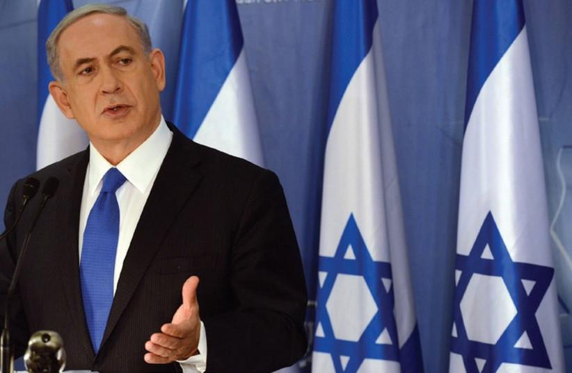 PRIME MINISTER Binyamin Netanyahu speaks at a press conference in Tel Aviv on Friday (photo credit: HAIM ZACH/GPO)