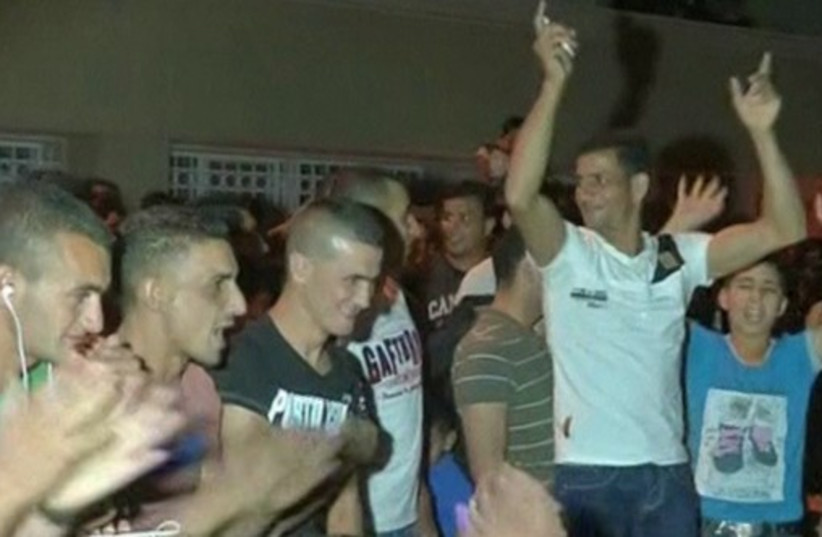 Palestinians in Hebron cheer as Gaza rockets fly toward Israeli population centers. (photo credit: screenshot)