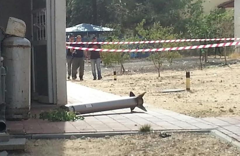Rocket falls in courtyard of home in Rishon Lezion (photo credit: YEHUDA REHAMIM/NEWS 24)