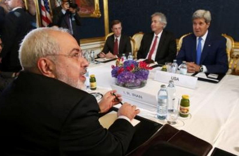 Iran's FM Javad Zarif (L) holds a bilateral meeting with US Secretary of State John Kerry (R) in talks over Tehran's nuclear program in Vienna, July 14, 2014. (photo credit: REUTERS)