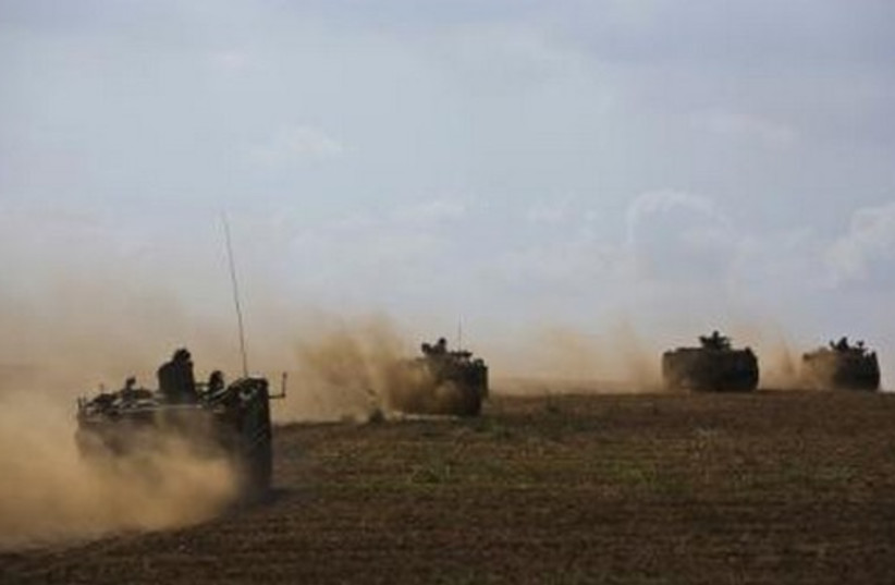 IDF armored personnel carriers (APCs) drive outside the Gaza Strip. (photo credit: REUTERS)