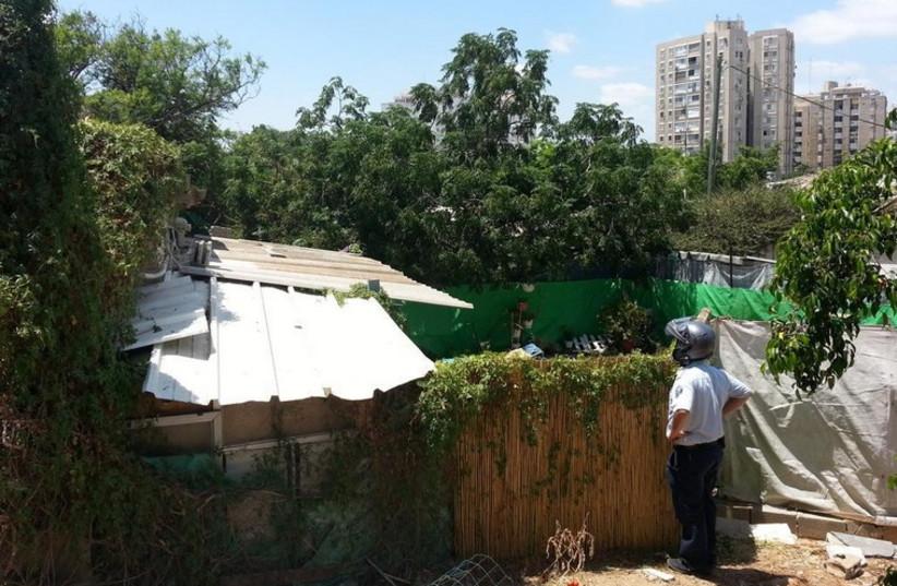 House in poor part of south Tel Aviv where rocket shrapnel crashed through roof  (photo credit: BEN HARTMAN)