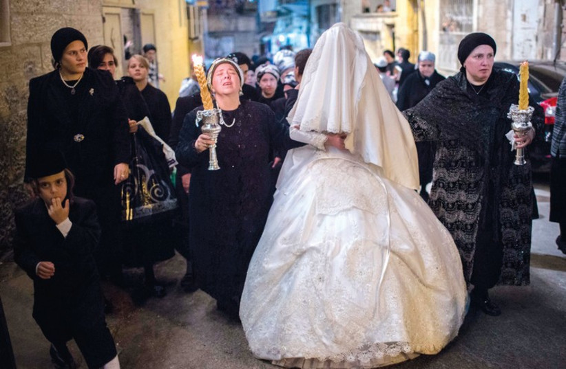 HUNDREDS OF hassidic ultra- Orthodox Jews attend a wedding in Mea She'arim. (photo credit: YONATHAN SINDEL / FLASH 90)