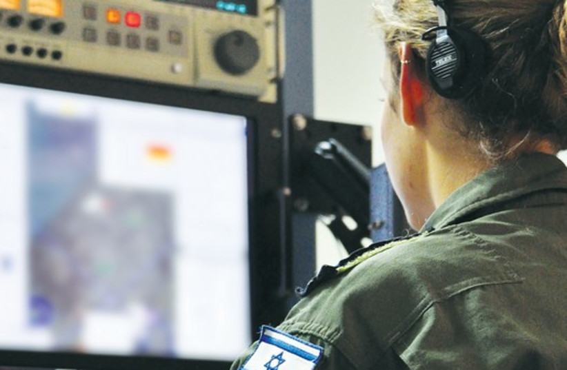 An officer monitors intelligence from Gaza in IAF headquarters. (photo credit: HAGAR AMIBAR)