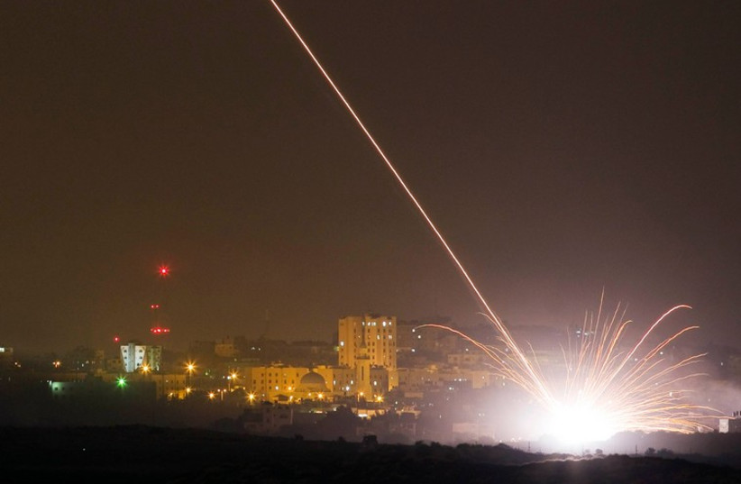 An Israeli rocket is fired into the northern Gaza Strip July 17 2014. (photo credit: REUTERS)