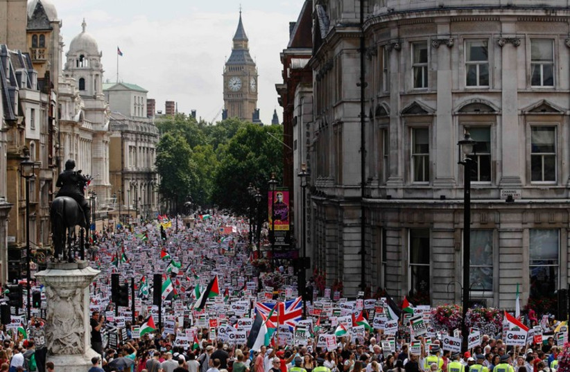 Demonstrators march in central London July 19 (photo credit: REUTERS)