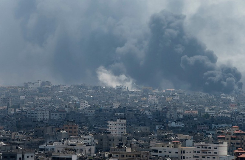Smoke rises from Gaza's Shejaia district (photo credit: REUTERS)