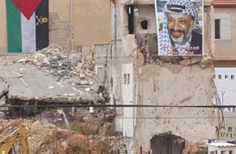 arafat poster mukata 298 (photo credit: AP)