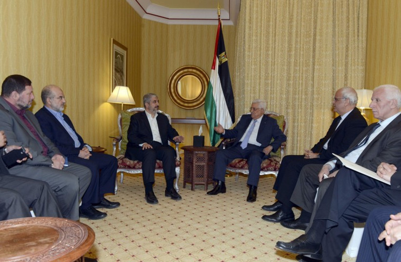 Palestinian President Mahmoud Abbas meets with Hamas leader Khaled Meshaal in Doha (photo credit: REUTERS)