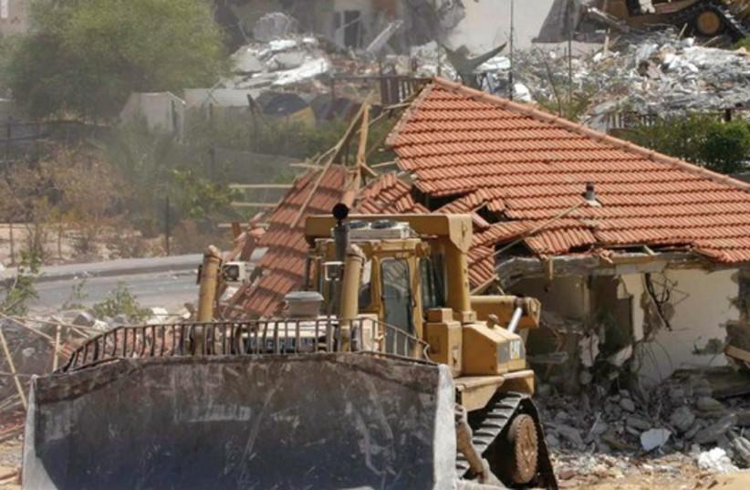 Israeli bulldozers demolish homes in the Neve Dekalim settlement in the Gaza Strip, August 31, 2005 (photo credit: MOTI MILROD / REUTERS)