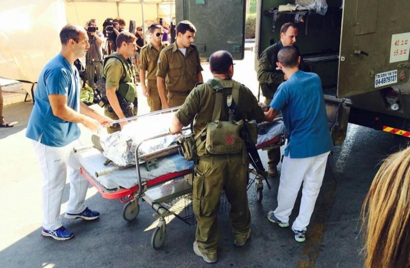 Wounded soldiers arrive at Soroka Medical Center in Beersheba (photo credit: MARC ISRAEL SELLEM/THE JERUSALEM POST)