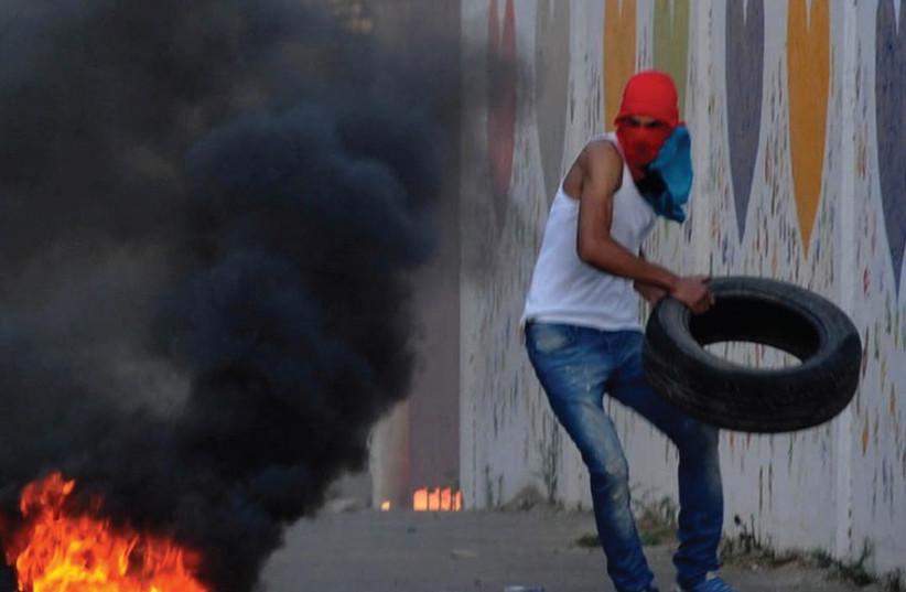 Israeli Arabs clash with border police during rioting in Wadi Ara (photo credit: IZIK BARBI / FLASH 90)