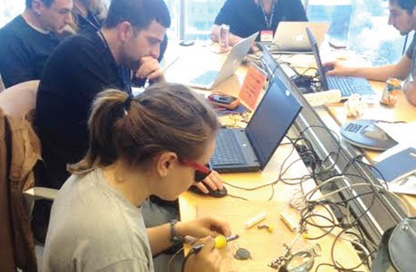 PARTICIPANTS IN the Israel Tech Challenge work during the 36-hour hackathon in Tel Aviv this week (photo credit: ISRAEL TECH CHALLENGE)