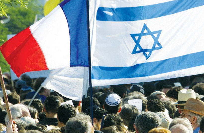 A French and Israeli flag are seen during a 2001 demonstration in Paris. (photo credit: REUTERS)