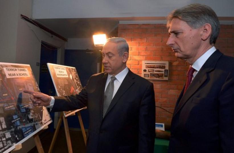 Pm Netanyahu and Britian Foreign Secretary Philip Hammond. (photo credit: HAIM ZACH/GPO)