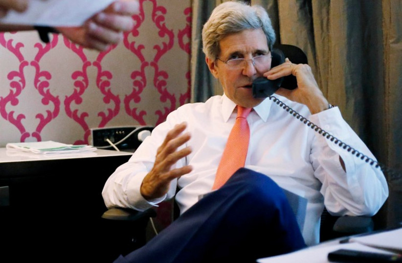 US Secretary of State John Kerry speaks on the phone to Prime Minister Binyamin Netanyahu, from his hotel suite in Cairo July 25, 2014. (photo credit: REUTERS)