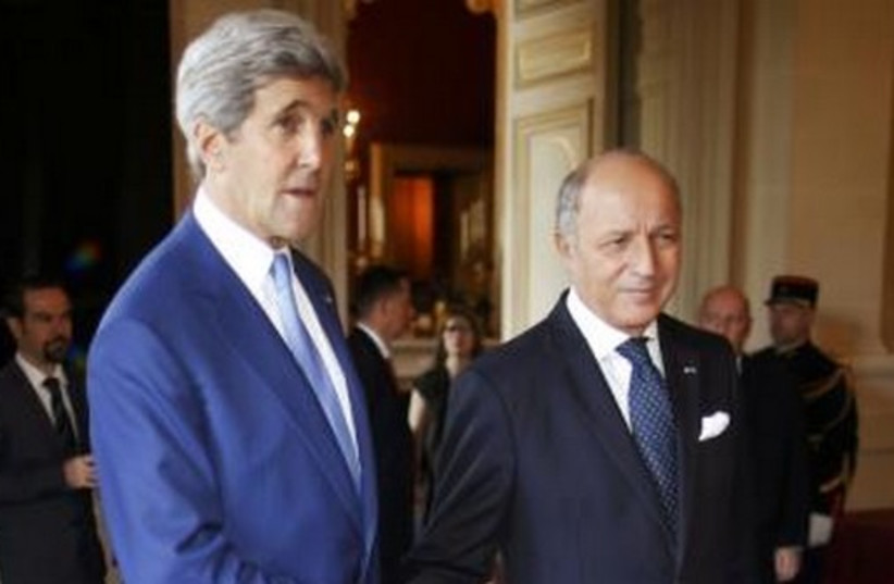 US Secretary of State John Kerry (L) and France's Foreign Minister, Laurent Fabius, in Paris July 26, 2 (photo credit: REUTERS)