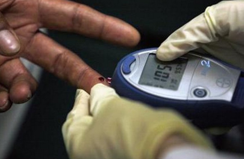 A diabetic has his blood sugar level measured in downtown. (photo credit: REUTERS)