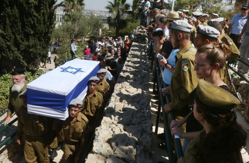 Mourners attend the funeral of St.-Sgt. Amit Yaori in Jerusalem. (photo credit: MARC ISRAEL SELLEM)
