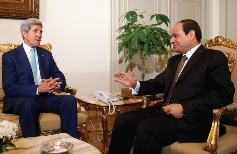 US Secretary of State John Kerry (left) meets with Egyptian President Abdel Fatah al-Sisi in Cairo. (photo credit: REUTERS)