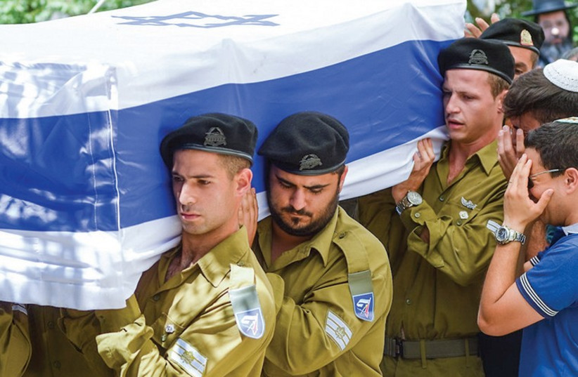 Soldiers carry the coffin of St.-Sgt. Eliav Eliyahu Haim Kahlon during his funeral at the Safed Military Cemetery. (photo credit: FLASH 90)