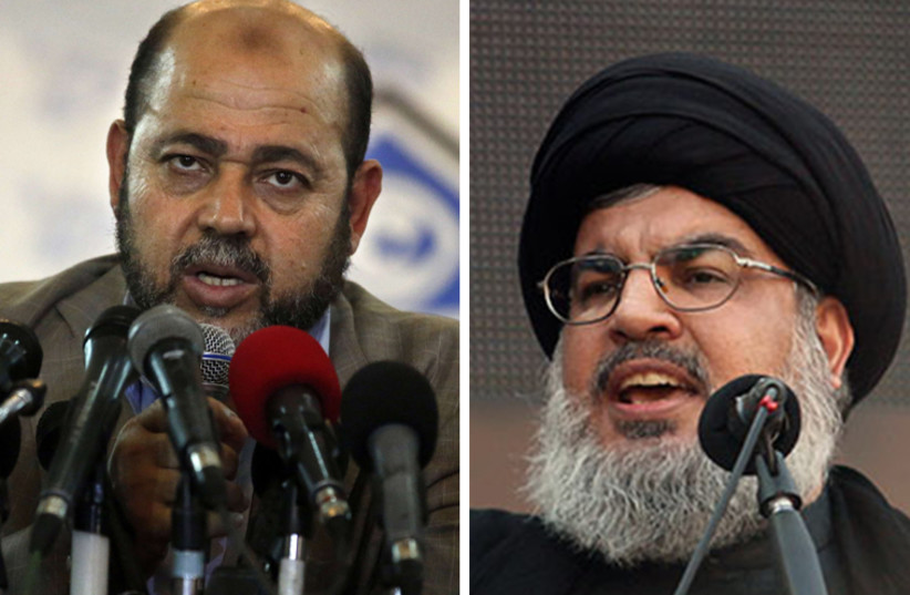 Hezbollah leader Hassan Nasrallah (R) and Hamas deputy political bureau chief Moussa Abu Marzouk‏ (photo credit: REUTERS)